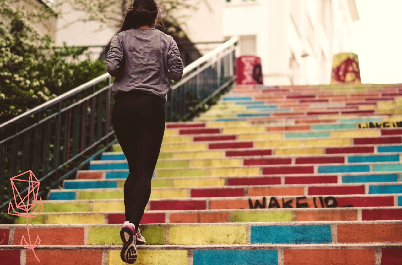 Woman running up brightly coloured steps outdoors